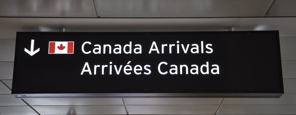 Immigrate to Canada. Canada arrivals sign post