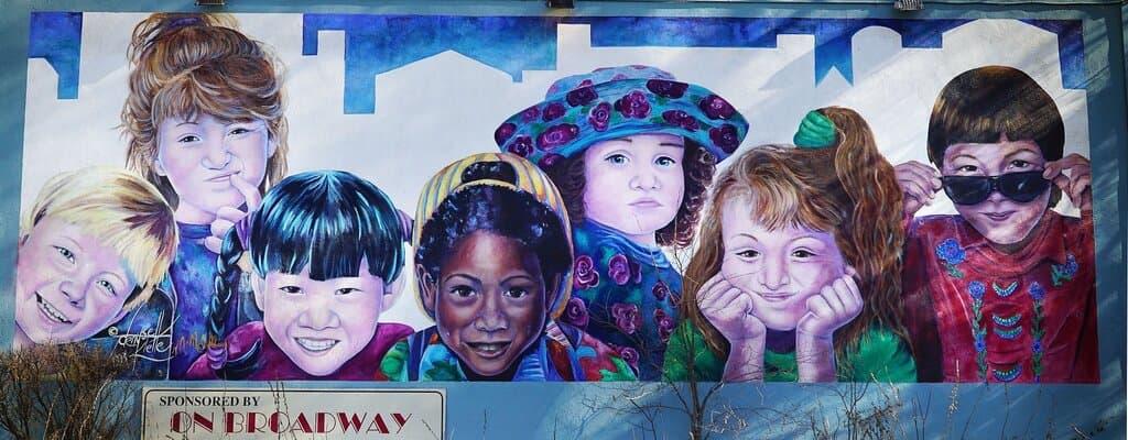 Saskatchewan Immigrant Nominee Program (SINP) - Multi-racial kids on a billboard